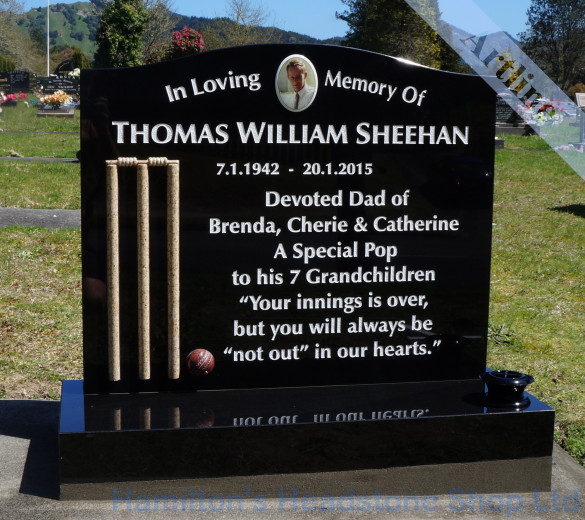 cricket wickets and ball headstone