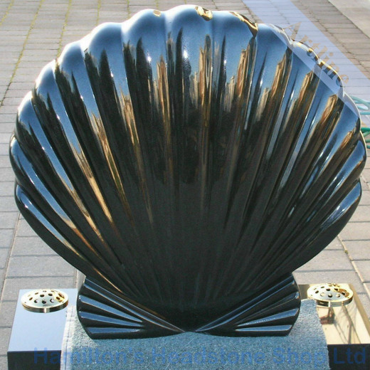carved sea shell headstone